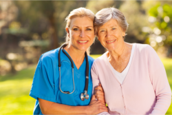 a nurse and an old woman in the garden