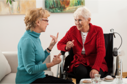 lady talking to an old woman